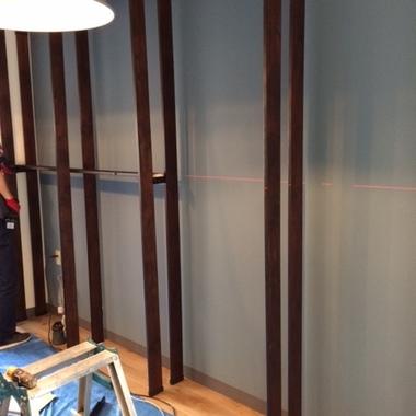 壁面一面に書棚を設置。の施工後写真(0枚目)