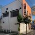 外壁塗装/東京都八王子市/オレンジ一色からツートンカラーへ変更の施工後写真(2枚目)