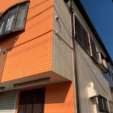 外壁塗装/東京都八王子市/オレンジ一色からツートンカラーへ変更の施工後写真(4枚目)